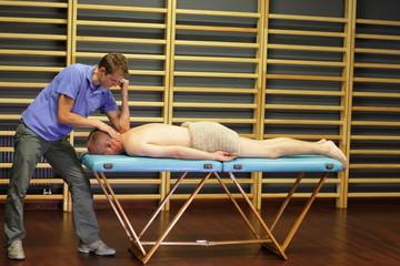 male therapist massaging middle age caucasian man back