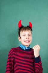 Funny bad child devil winner smiling