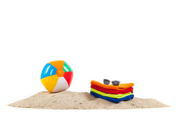 Toys and towels at the beach