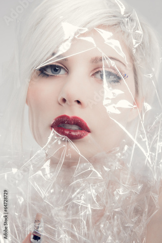 Blonde woman model wrapped in plastic