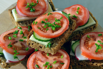 Wholemeal rye bread sandwich with tomato, cucumber, radish and c