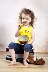 Little girl eating nectarine