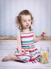 Little girl eating corn puffed sticks