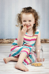 Little girl eating sponge biscuit