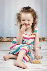 Little girl eating sponge biscuit