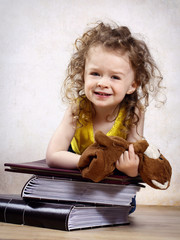 Little girl with photo albums