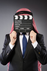 Arab businessman with movie board
