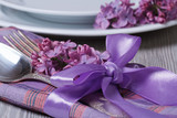 table setting decorated with fragrant lilac flowers