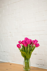 beautiful pink tulips in a vase