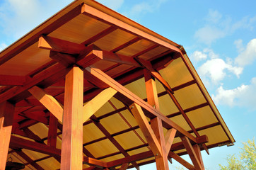 Low angle shot of a patio pergola on the background of  sky