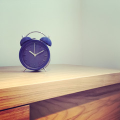 Blue old-fashioned alarm clock