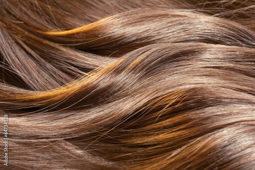 Beautiful healthy shiny hair texture with highlighted streaks - 64734528
