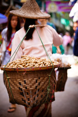 Woman Carrying Peanut Baskets - Golden Triangle, Thailand