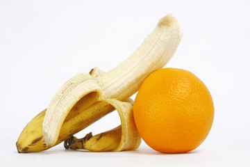 Fresh ripe bananas bunch and orange isolated on white background
