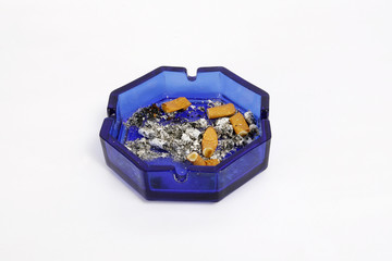 a lot of cigarettes in an ashtray