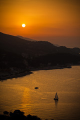 Mountain Sunset with Sailboat