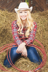Smiling Cowgirl With Lasso Rope in Cattleshed