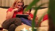 dolly shot mother and son using digital tablet in home