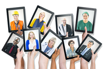 Group of Hands Holding Tablets with People's Faces