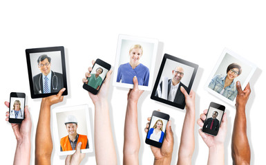 Hands Holding Digital Devices with Professional People's Images