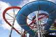 colorful water aqua park pipe on blue sky background