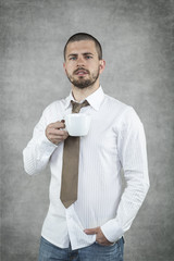 Businessman drinking his coffee