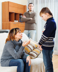 Mother and father scolding teenager