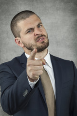 Angry Businessman pointing at you