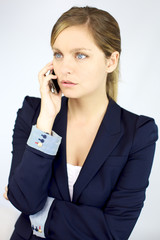 Serious gorgeous blond business woman on the phone