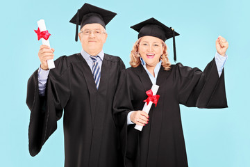 Mature people celebrating their graduation