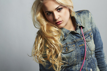 fashionable beautiful girl in jeans.denim jeans wear.blond woman