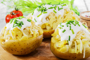 whole baked potato with cheese and sauce