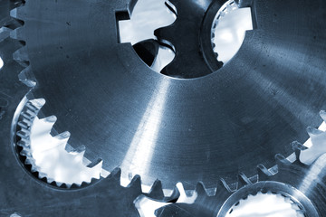 titanium and steel gears and cogwheels in close-ups