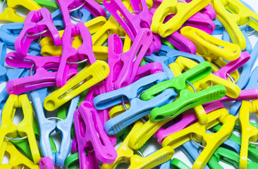 plastic clothes pegs on a white background