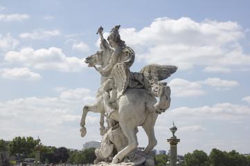 Ancient sculpture in Paris over the blue sky
