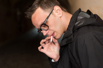 Closeup of young man smoking a cigarette