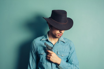 Young cowboy with revolver
