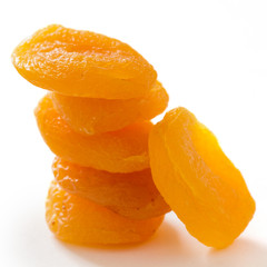 Stack of dried apricots on white surface