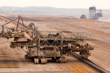 a cconveyor belt and an excavator in a lignite mine