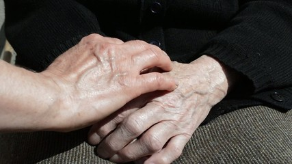 Comforting an elderly pair of hands.