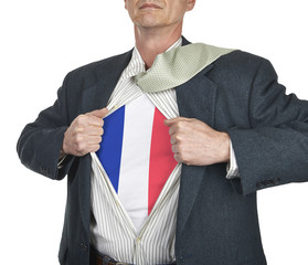 Businessman showing French flag superhero suit underneath his sh