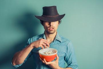 Cowboy eating popcorn