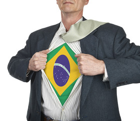 Businessman showing brazil flag superhero suit underneath his sh