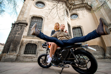 Couple having fun on the motorcycle in the old city