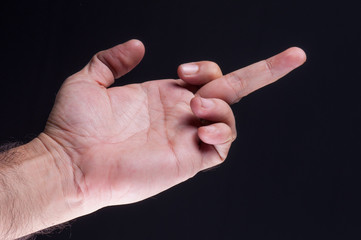 Man's hand showing the middle finger
