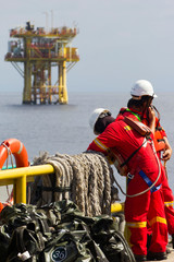 Rig workers and an oil platform