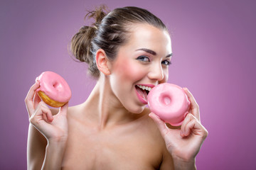 Beautiful woman with two donuts. You may eat or not?
