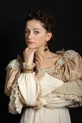 Girl in baroque dress looking at camera