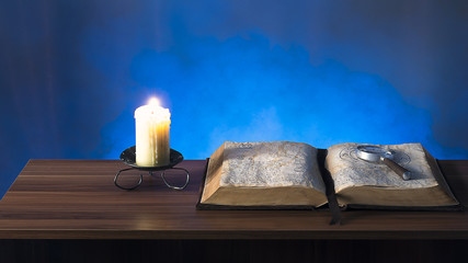 Book and candle on the table