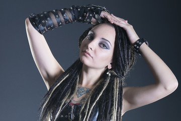 Brunette girl with dreadlocks